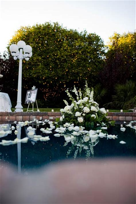 Flowers Floating In Pool Backyard Wedding Ideas Backyard Pool Wedding Ideas