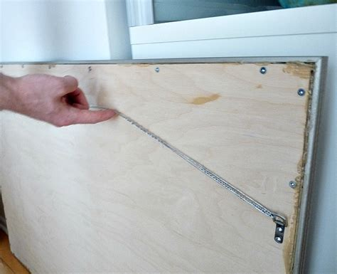 how to hang a bathroom mirror how to hang a heavy mirror on brick how to drill into