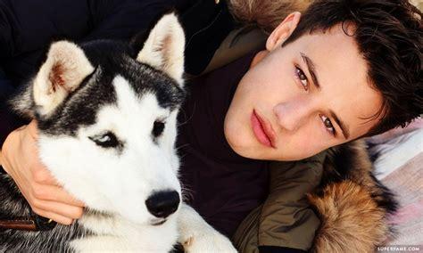 dfw puppy cameron dallas adopts some random at a photoshoot superfame