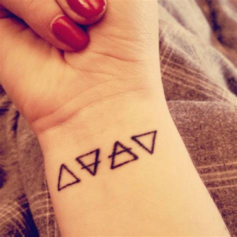elements tattoo wrist of the alchemic symbols of four basic