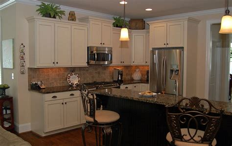 what color granite with white cabinets and dark wood floors corner on pastel wall paint black glass tile backsplash