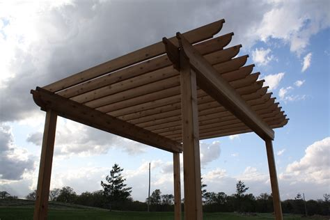 The Hansen Family How To Build A Pergola Pergola Rafter Ends