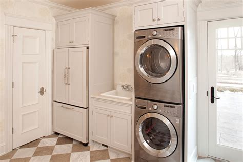 Kitchen Floor To Ceiling Cabinets stacked washer dryer laundry room traditional with brown