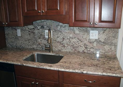 White And Dark Kitchen Cabinets by White Spring Granite