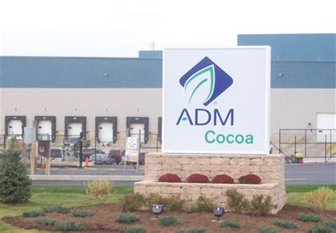 adm completes cocoa business sale to olam food business news