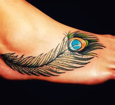 feather tattoo places 8 peacock feather tattoo meanings youqueen
