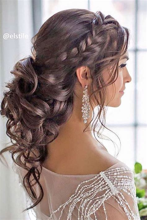 hairstyles with loose curls and braids braided loose curls low updo wedding hairstyle low updo