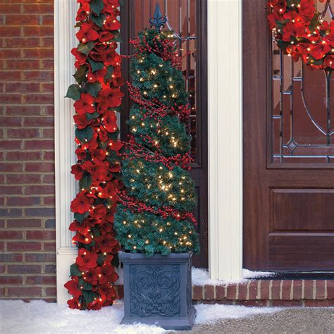 spiral topiary urn with red berry lights 6 frontgate