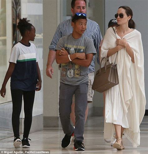 Bag For Babies Zahara Joli Pitt With Valentino Histoire Bag by Wears Flowing White To Mall With Pax