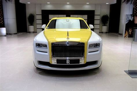 yellow rolls royce wraith rolls royce ghost in english white and semaphore yellow