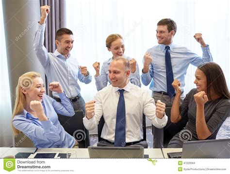 Raising S Corporate Office by Business Celebrating Victory In Office Stock Photo