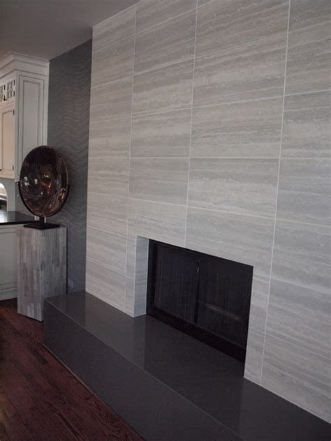 Contemporary tile fireplace contemporary living room chicago by normandy remodeling