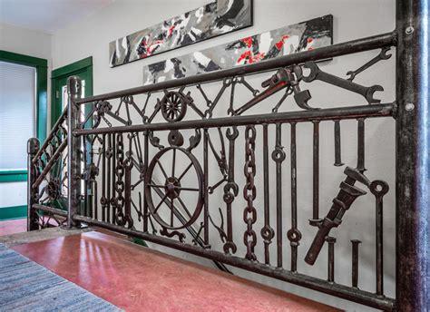 unique stair railing   repurposed materials