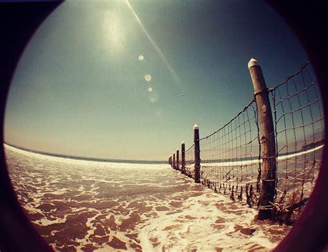wallpaper camera lomo lomography fisheye beach fence by hell0z0mbie on deviantart