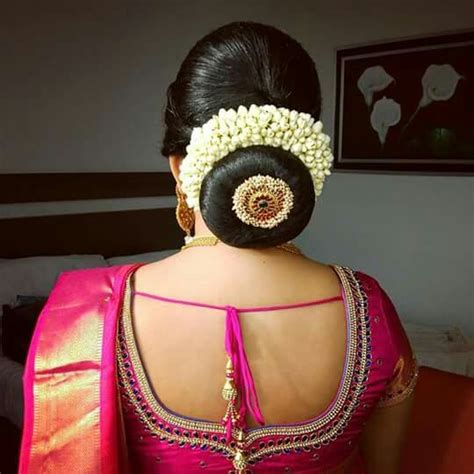 bridal hairstyles with gajra what a beautiful large low bun with gajra juda pin care