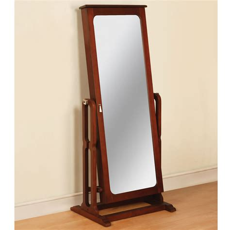 Standing Jewelry Armoire Mirror the free standing mirrored jewelry armoire hammacher schlemmer