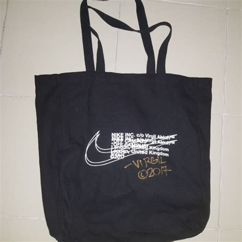 escalade commercial white guy carrying bags nike x off white london tote bag sign by virgil men s
