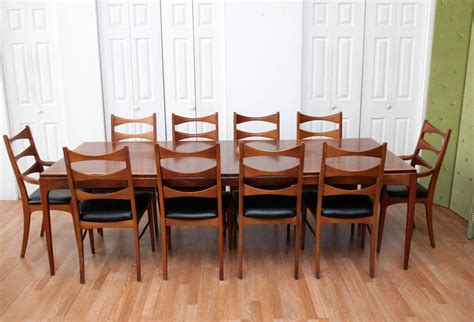 walnut dining room table and ten chairs at 1stdibs