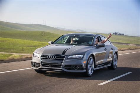 driving car audi s self driving car the steering wheel fortune