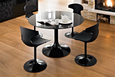 tulip chair and black glass dining table decor crave