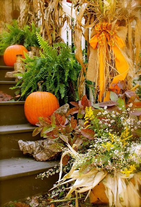 fall decorations with corn stalks pumpkins ferns and corn stalks autumn