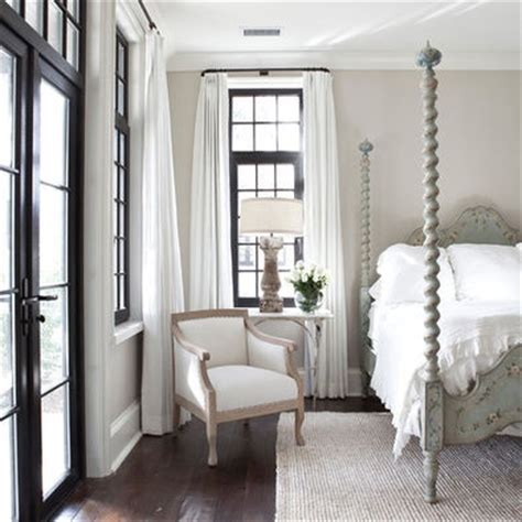 i the black trim with the light taupe walls and white linens jolene smith interiors