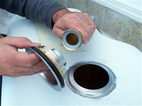 Replacing Plumbing by How To Install A Kitchen Sink Bob Vila