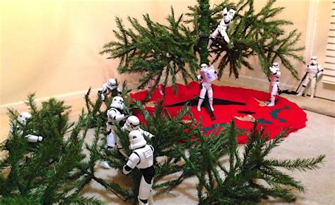 stormtroopers and darth vader put up christmas tree in