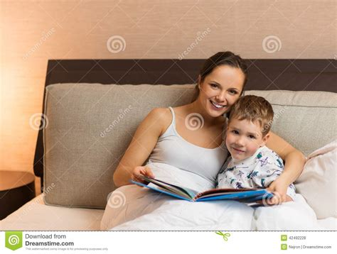 mom son bed mother and her son reading book stock photo image 42492228