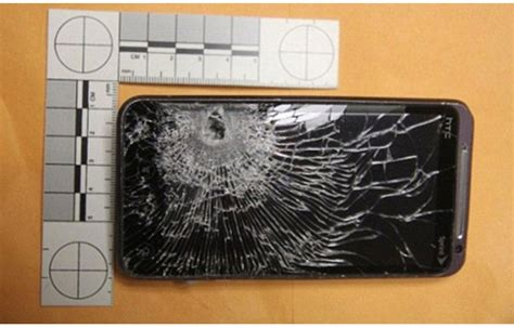 clerk s cellphone stops bullet
