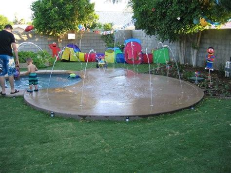 backyard splash pad and wading pool outdoor deco