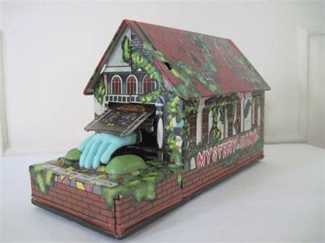 haunted house toy mystery bank 1950s wind up tin toy haunted house with monster han