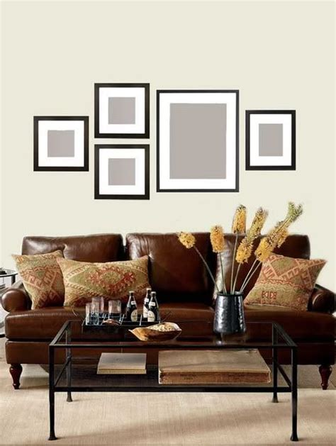 hanging pictures over sofa 25 best ideas about photo wall arrangements on pinterest