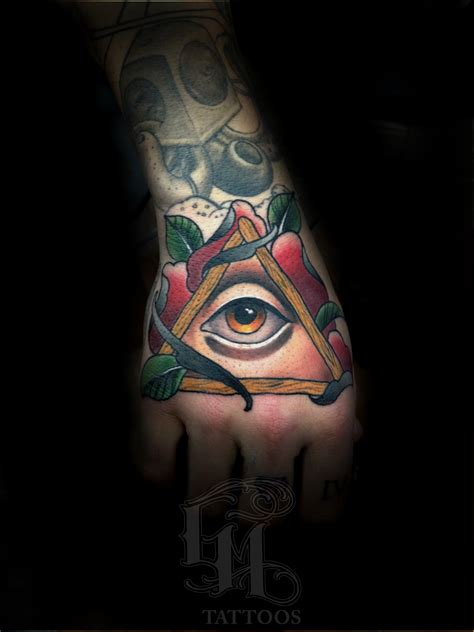 rose with eye tattoo graham mowers certified artist