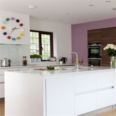 kitchen feature wall ideas white kitchen with lilac feature wall and bright clock