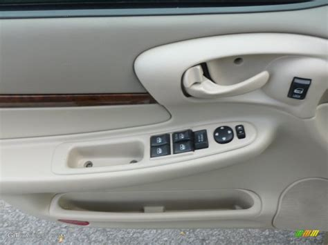 Neutral Ls 2004 Chevrolet Impala Ls Neutral Beige Door Panel Photo