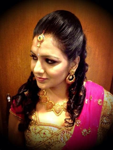 south indian bridal reception hairstyle   Indian bridal