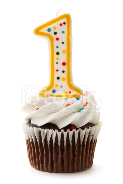 Cupcake Tier Candle Cupcake one birthday cupcake with number 1 candle stock photos