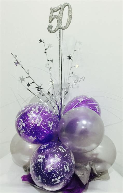 50th birthday balloon table centerpiece in purple and