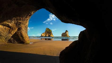 nature landscape clouds cave rock sea horizon