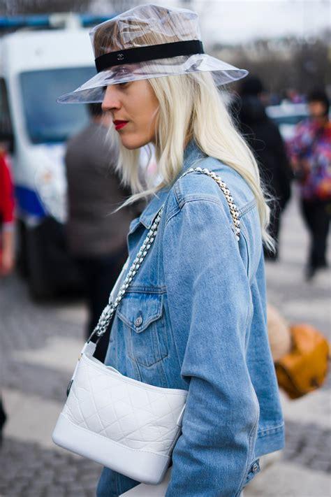 people   wearing chanels pvc plastic hats instylecom