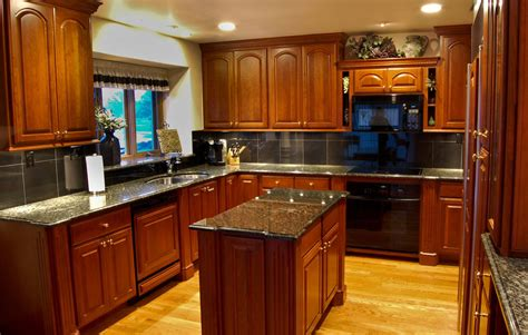 Cherry Wood Kitchen Cabinets With Black Granite Furniture Light Wood Flooring With Black Granite Countertop And Glass Window Plus Recessed