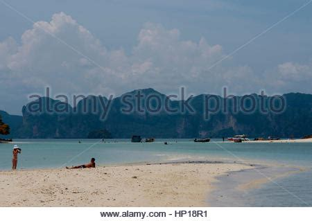 public boat r runaway bay visitors on the exotic white sand beach ko tup island off