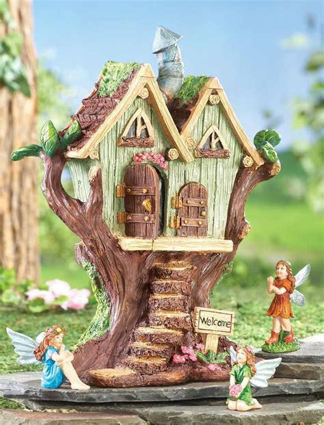 decorative fairy tree house with 3 fairy figurine outdoor