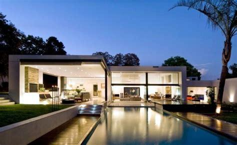 Urban Vertical Garden - contemporary prefab house in the bauhaus style with glass facade and pool in the garden