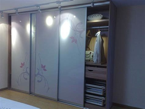 Sliding Door Systems For Wardrobes by Suggestions For Wardrobe In Small Apartment