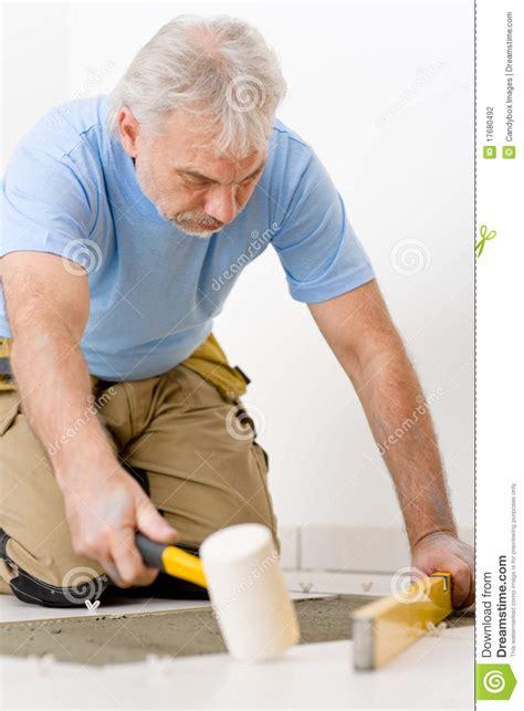 home improvement renovation laying tile stock