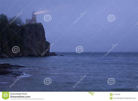 light across the ocean rock lighthouse lit stock photo image 14761220