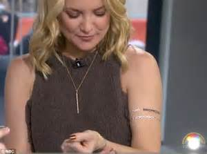 kate hudson tattoos kate hudson braves the snow in new york city to promote