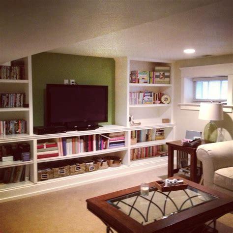 how to build a room in a basement basement rec room tv room built in shelves follow